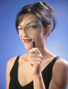 woman_with_magnifying_glass_cropped.jpg